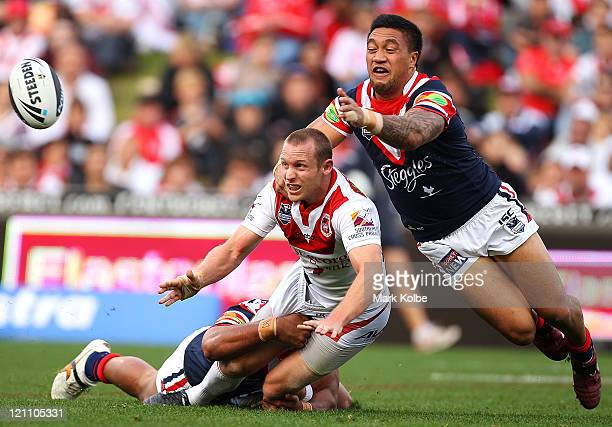 Ben Hornby of the Dragons is tackled during the round 23 NRL match between the St George Illawarra Dragons and the Sydney Roosters at WIN Stadium on...