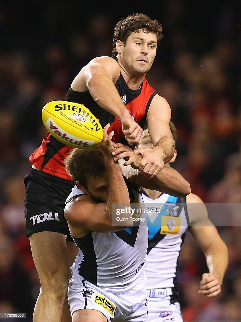 Ben Howlett of the Bombers spoils a mark by Tom Logan of the Power during the round 15 AFL match between the Essendon Bombers and Port Adelaide Power at Etihad Stadium on July 7, 2013 in Melbourne, Australia.