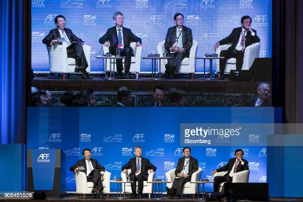 Ben Hung chief executive officer of Retail Banking at Standard Chartered Plc from left Zhu Min president of National Institute of Finance Research at...