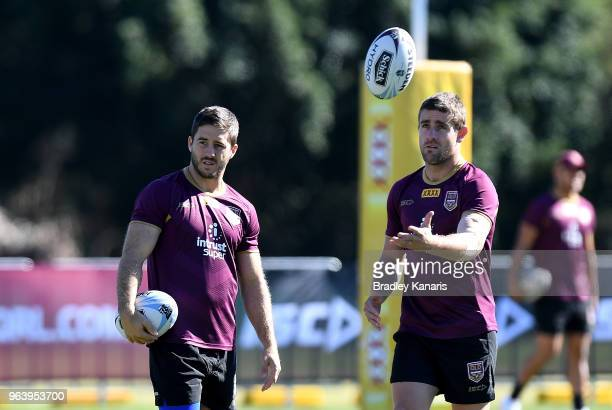 Ben Hunt and Andrew McCullough chat during a Queensland Maroons training session at Sanctuary Cove on May 31 2018 at the Gold Coast Australia