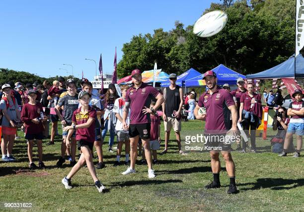Ben Hunt and Cameron Munster work with kids in an NRL clinic during a Queensland Maroons Fan Day on July 3 2018 in Hervey Bay Australia