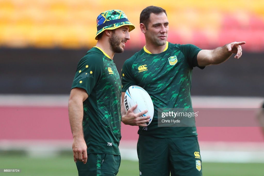 Ben Hunt and Cameron Smith talk during an Australian Kangaroos Rugby League World Cup training session at Suncorp Stadium on October 11, 2017 in Brisbane, Australia.
