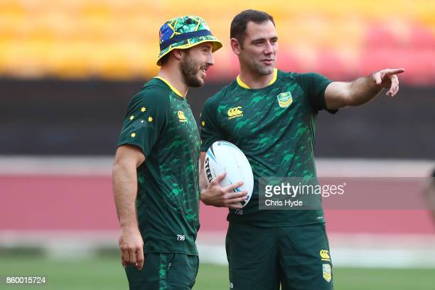 Ben Hunt and Cameron Smith talk during an Australian Kangaroos Rugby League World Cup training session at Suncorp Stadium on October 11 2017 in...