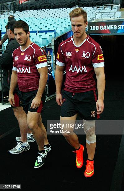 Ben Hunt and Daly Cherry Evans arrive at a Queensland Maroons State of Origin training session at ANZ Stadium on June 17 2014 in Sydney Australia