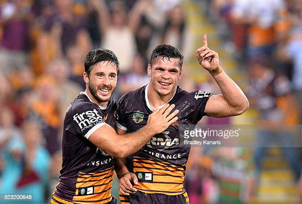 Ben Hunt and James Roberts of the Broncos celebrate a try during the round eight NRL match between the Brisbane Broncos and the South Sydney...