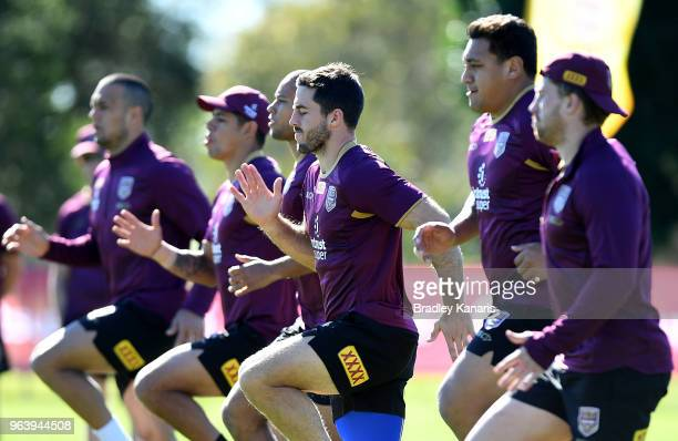 Ben Hunt and team mates warmup during a Queensland Maroons training session at Sanctuary Cove on May 31 2018 at the Gold Coast Australia