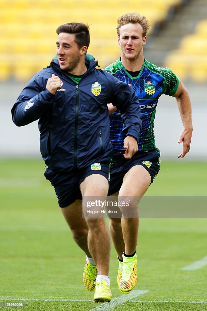 Ben Hunt is chased by Daly Cherry-Evans during an Australian Kangaroos training session at Westpac Stadium on November 14, 2014 in Wellington, New Zealand.