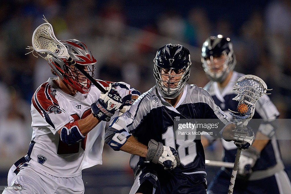 Ben Hunt #18 of Chesapeake Bayhawks runs up field past Brent Adams #28 of Boston Cannons during a game at Navy-Marine Corps Memorial Stadium on July 18, 2013 in Annapolis, Maryland.