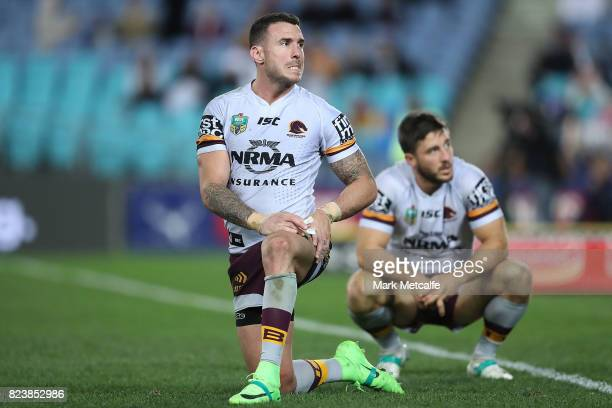Ben Hunt of the Broncos and Darius Boyd of the Broncos look dejected after defeat during the round 21 NRL match between the Parramatta Eels and the...