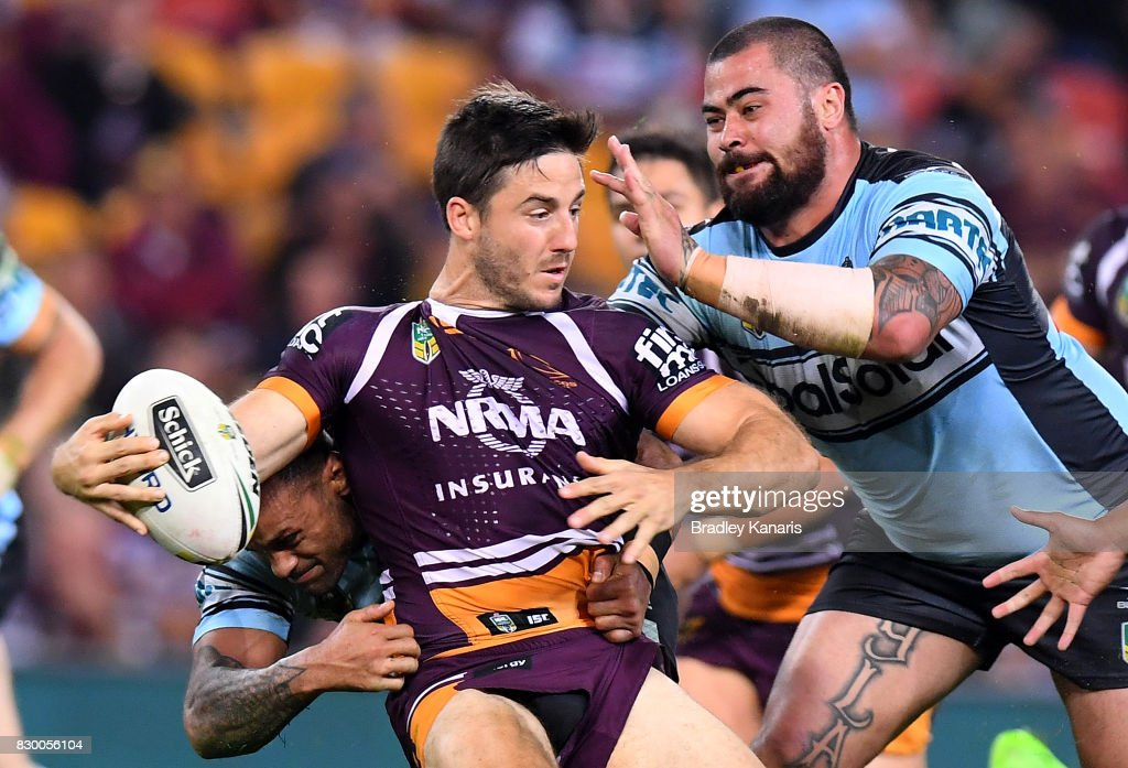 Ben Hunt of the Broncos attempts to break away from the defence during the round 23 NRL match between the Brisbane Broncos and the Cronulla Sharks at Suncorp Stadium on August 11, 2017 in Brisbane, Australia.