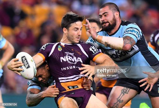 Ben Hunt of the Broncos attempts to break away from the defence during the round 23 NRL match between the Brisbane Broncos and the Cronulla Sharks at...