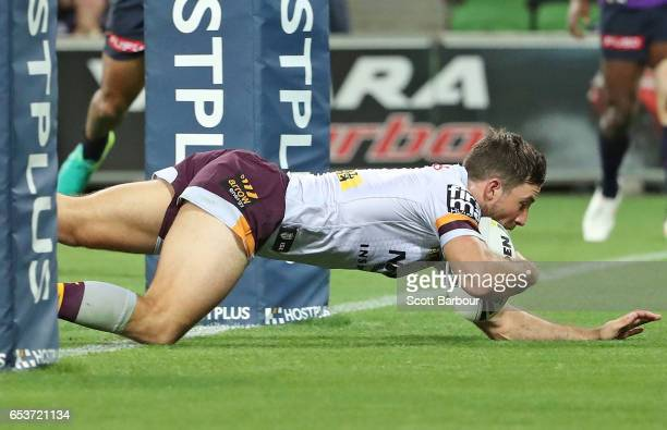 Ben Hunt of the Broncos beats the Storm defence to score a try during the round three NRL match between the Melbourne Storm and the Brisbane Broncos...