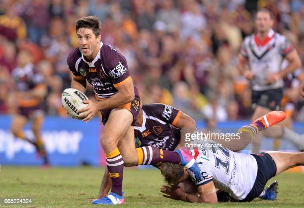 Ben Hunt of the Broncos breaks away from the defence during the round six NRL match between the Brisbane Broncos and the Sydney Roosters at Suncorp...