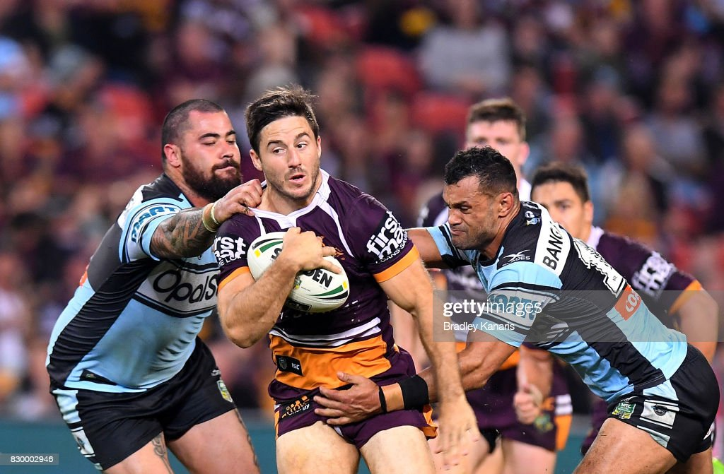 Ben Hunt of the Broncos breaks through the defence during the round 23 NRL match between the Brisbane Broncos and the Cronulla Sharks at Suncorp Stadium on August 11, 2017 in Brisbane, Australia.