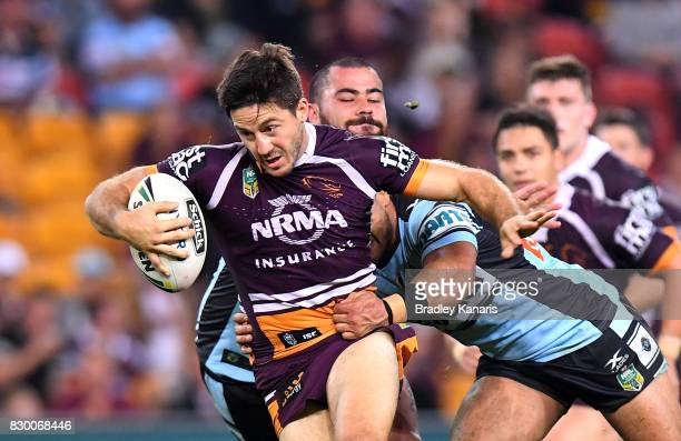 Ben Hunt of the Broncos breaks through the defence during the round 23 NRL match between the Brisbane Broncos and the Cronulla Sharks at Suncorp...
