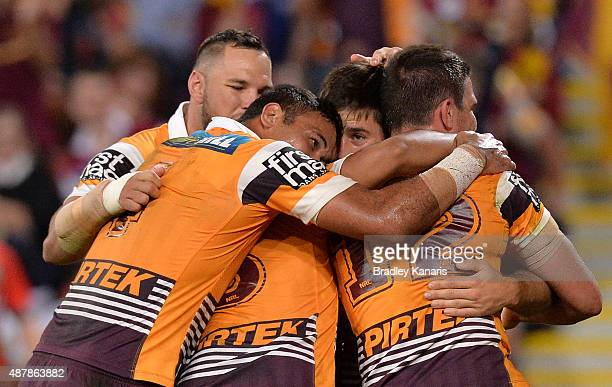Ben Hunt of the Broncos celebrates scoring a try during the NRL Qualifying Final match between the Brisbane Broncos and the North Queensland Cowboys...