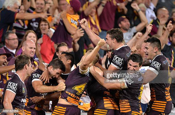 Ben Hunt of the Broncos celebrates with team mates after scoring the match winning try during the round six NRL match between the Brisbane Broncos...