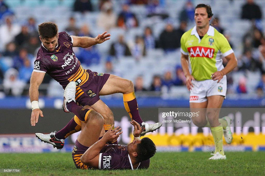 Ben Hunt of the Broncos collides with a teammate during the round 16 NRL match between the Canterbury Bulldogs and Brisbane Broncos at ANZ Stadium on June 25, 2016 in Sydney, Australia.