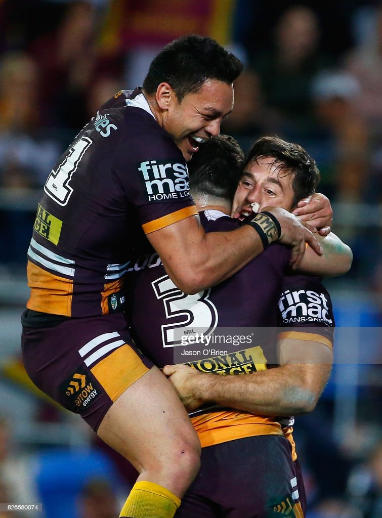 Ben Hunt of the broncos is congratulated after scoring a try during the round 22 NRL match between the Gold Coast Titans and the Brisbane Broncos at Cbus Super Stadium on August 5, 2017 in Gold Coast, Australia.