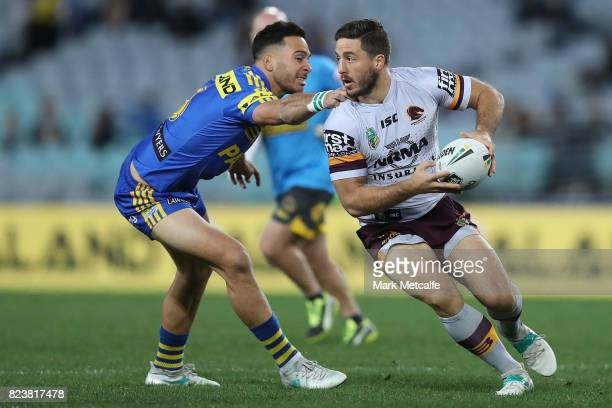 Ben Hunt of the Broncos is tackled by Corey Norman of the Eels during the round 21 NRL match between the Parramatta Eels and the Brisbane Broncos at...