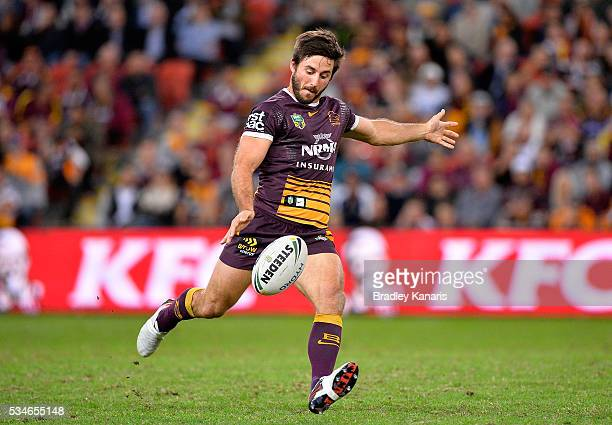Ben Hunt of the Broncos kicks the ball during the round 12 NRL match between the Brisbane Broncos and the Wests Tigers at Suncorp Stadium on May 27...