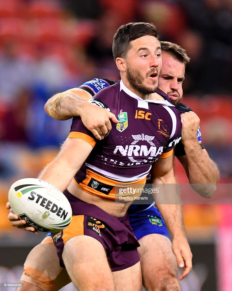 Ben Hunt of the Broncos offloads as he is pressured by the defence of Josh Reynolds of the Bulldogs during the round 20 NRL match between the Brisbane Broncos and the Canterbury Bulldogs at Suncorp Stadium on July 20, 2017 in Brisbane, Australia.