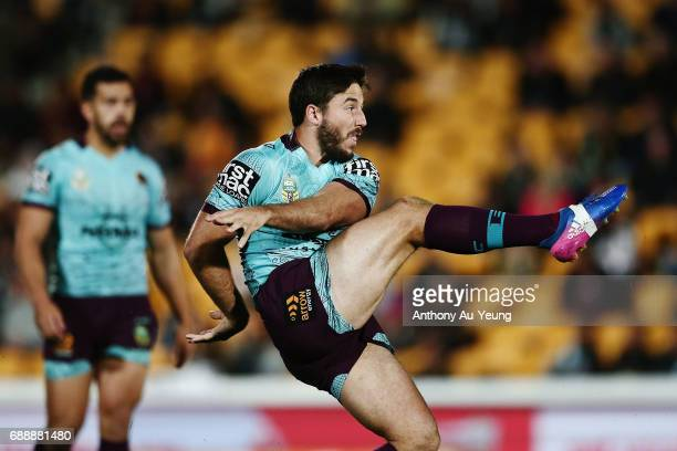 Ben Hunt of the Broncos puts in a kick during the round 12 NRL match between the New Zealand Warriors and the Brisbane Broncos at Mt Smart Stadium on...