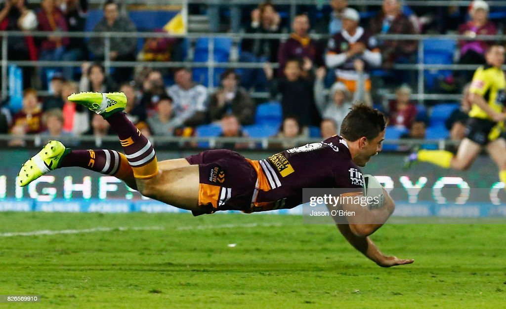 Ben Hunt of the Broncos scores a try during the round 22 NRL match between the Gold Coast Titans and the Brisbane Broncos at Cbus Super Stadium on August 5, 2017 in Gold Coast, Australia.