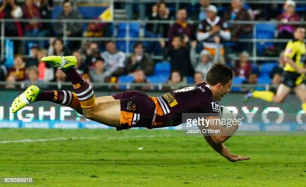 Ben Hunt of the Broncos scores a try during the round 22 NRL match between the Gold Coast Titans and the Brisbane Broncos at Cbus Super Stadium on...