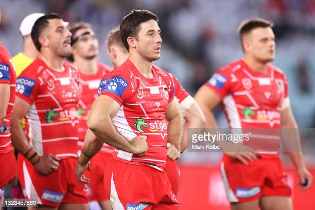 Ben Hunt of the Dragons and his team look dejected after a try during the round 14 NRL match between the Canterbury Bulldogs and the St George...