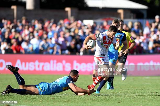 Ben Hunt of the Dragons breaks through the defence during the round three NRL match between the Gold Coast Titans and the St George Illawarra Dragons...