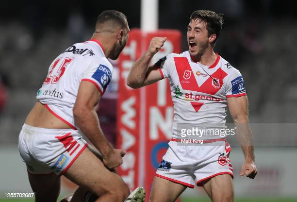 Ben Hunt of the Dragons celebrates after Josh Kerr of the Dragons scored a try during the round nine NRL match between the St George Illawarra...