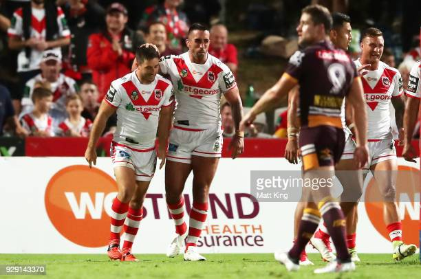 Ben Hunt of the Dragons celebrates with Paul Vaughan of the Dragons after scoring an intercept try during the round one NRL match between the St...