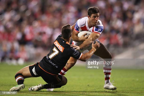 Ben Hunt of the Dragons is tackled by Luke Brooks of the Tigers during the round eight NRL match between the St George Illawarra Dragons and the...