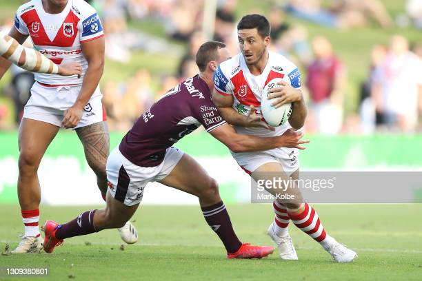 Ben Hunt of the Dragons is tackled during the round three NRL match between the St George Illawarra Dragons and the Manly Warringah Sea Eagles at WIN...