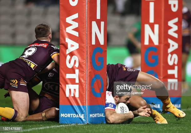 Ben Hunt of the Dragons scores a try during the round 13 NRL match between the St George Illawarra Dragons and the Brisbane Broncos at Netstrata...
