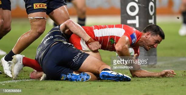 Ben Hunt of the Dragons scores a try during the round two NRL match between the North Queensland Cowboys and the St George Illawarra Dragons at QCB...