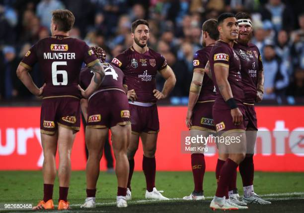 Ben Hunt of the Maroons and team mates look dejected after a Blues try during game two of the State of Origin series between the New South Wales...