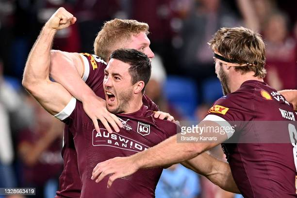 Ben Hunt of the Maroons celebrates with team mates after scoring a try during game three of the 2021 State of Origin Series between the New South...
