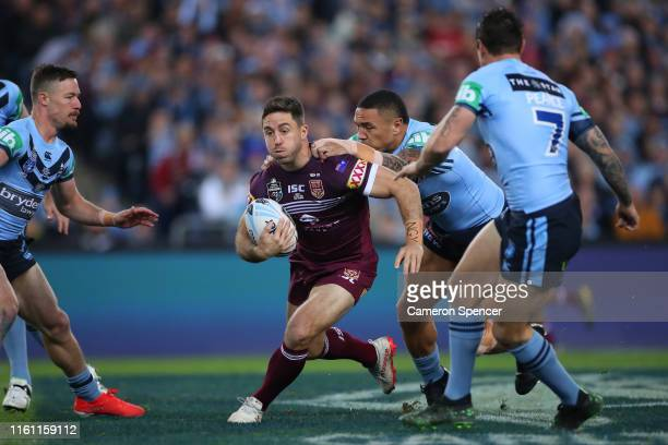 Ben Hunt of the Maroons is tackled during game three of the 2019 State of Origin series between the New South Wales Blues and the Queensland Maroons...