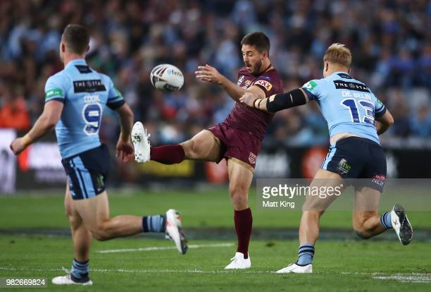 Ben Hunt of the Maroons kicks during game two of the State of Origin series between the New South Wales Blues and the Queensland Maroons at ANZ...