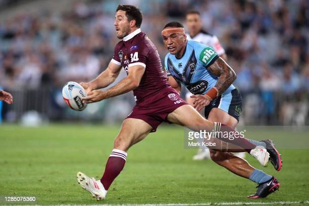 Ben Hunt of the Maroons offloads during game two of the 2020 State of Origin series between the New South Wales Blues and the Queensland Maroons at...