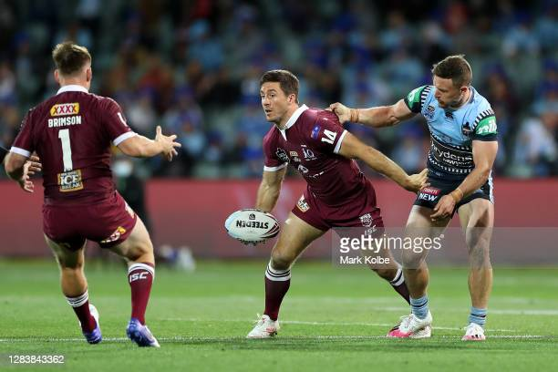 Ben Hunt of the Maroons offloads the ball during game one of the 2020 State of Origin series between the Queensland Maroons and the New South Wales...