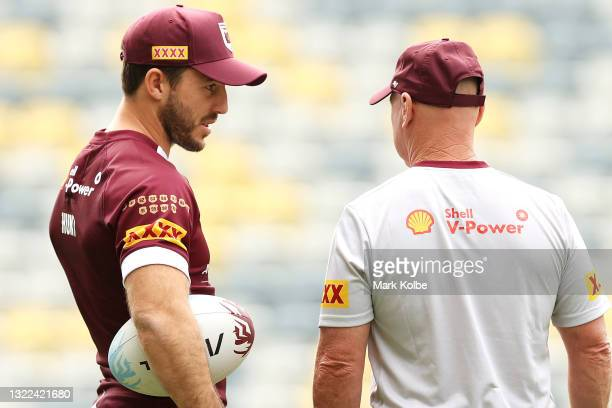 Ben Hunt speaks to Allan Langer during a Queensland Maroons State of Origin training session at Queensland Country Bank Stadium on June 08, 2021 in...