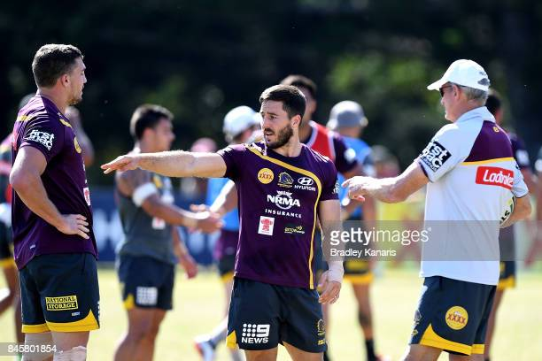 Ben Hunt talks tactics with Coach Wayne Bennet and team mate Corey Oates during a Brisbane Broncos NRL training session on September 12 2017 in...