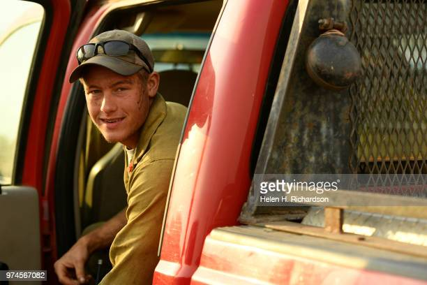 Ben Hurd a firefighter with a Type II hand crew with Idaho Department of Lands gets ready to head out for the day on the fire line of the 416 Fire on...