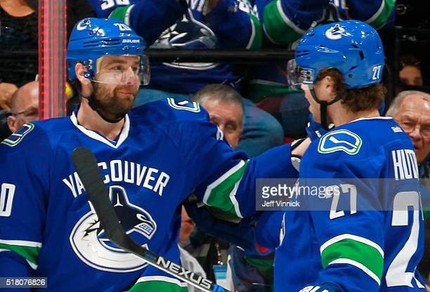 Ben Hutton congratulates Chris Higgins of the Vancouver Canucks who scored a shorthanded goal against the San Jose Sharks during their NHL game at...