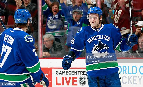 Ben Hutton congratulates Jake Virtanen of the Vancouver Canucks who scored against the San Jose Sharks during their NHL game at Rogers Arena March 3...