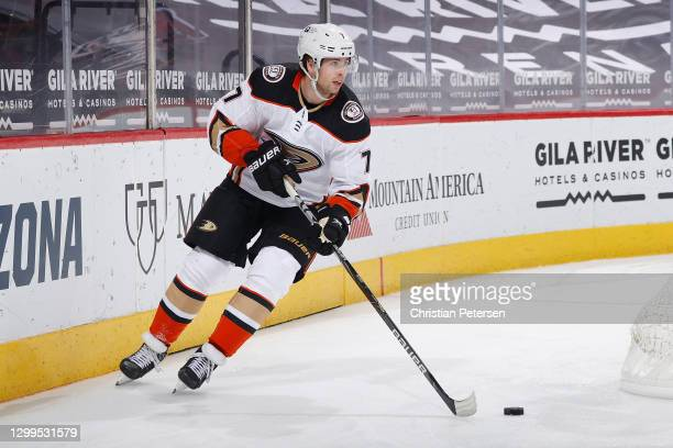 Ben Hutton of the Anaheim Ducks skates with the puck against the Arizona Coyotes during the third period of the NHL game at Gila River Arena on...