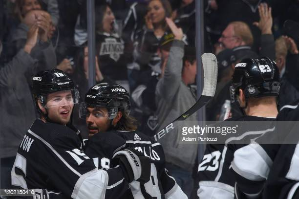 Ben Hutton of the Los Angeles Kings celebrates his goal with Alex Iafallo during the third period against the Florida Panthers at STAPLES Center on...